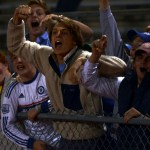 Students in the student section rush down to the fence during overtime to pump up the team. Photo by Audrey Kesler