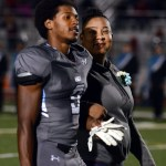 Senior Nigil Houston walks off the field with his mother after taking his Senior Night photo. Photo by Audrey Kesler