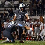 Sophomore Parker Willis kicks the extra point after an east touchdown. Photo by Audrey Kesler