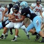 Senior Calvin Ball secures a defensive team tackle. Photo by Audrey Kesler
