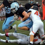 Junior Milton Brasch steps over a player attempting to gain a few extra yards. Photo by Audrey Kesler