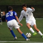 Sophomore Micheal O'Toole battles to take the ball from a Rockhurst player. Photo by Caroline Mills