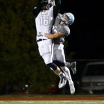 Sophomore Garrett Boschen tackles a Northwest player in the second half of the game. Photo by Diana Percy