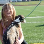 Senior Sarah Milgrim's younger sister hugs a dog excitedly before the race. Photo by Diana Percy