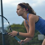Senior Quincy Bair waits as her doubles partner takes their first serve. Photo by Morgan Plunkett