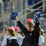 Freshman Elise Griffith cheers on the Lancers from the sidelines. Photo by Katherine Odell
