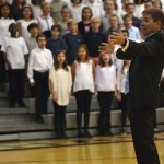 Mr. Foley directs the choraliers and the middle school choir during the final song 'God Bless America'. Photo by Morgan Plunkett