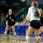 Junior Sydney Asher yells for junior libero, Ally Huffman, to take the pass. Photo by Kaitlyn Stratman