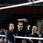 Freshman middle, Brigid Wentz, watches as the ball rolls on the net. It landed on Manhattan's side, bringing the team one point away from their win. Photo by Kaitlyn Stratman