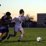 Senior Will Krebs pulls ahead of his opponents as they race him for the ball. Phot
