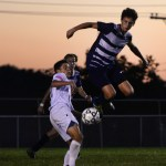 Senior and captain, Oliver Bihuniak, stays on the ground to gain possession of the ball. Photo by Kaitlyn Stratman