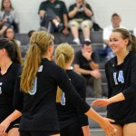 Senior Sara Madox high fives teammate Sydney Ashner before getting back in the game. Photo by Katherine Odell