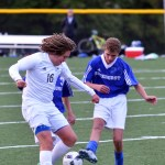 Sophomore Austin Brende tries to keep possession of the ball from the opposing team. Photo by Katherine Odell