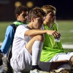 Senior Taylor Stover, senior Grant Rosener, and sophomore Brandon McGaugh sit and listen intently during halftime of SME soccer's first playoff game. Photo by Katherine Odell