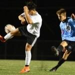 Senior Oliver Bihuniak kicks the ball down the field. Photo by Carson Holtgraves