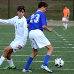 Sophomore Micheal O'Toole watches the ball after it is stolen by his defender. Photo by Ellen Swanson