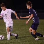 Senior Oliver Bihuniak turns the ball to dodge a Mill Valley defender. Photo by Haley Bell