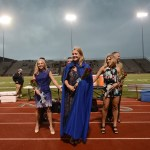 The Homecoming Queen, senior Anna Dierks, stands with first attendant senior Katie Kuhlman and second attendant senior Allie Libeer. Photo by Haley Bell