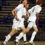 Senior Clayton Phillips celebrates junior Tommy Nelson's goal during the second half. Photo by Sophie Storbeck