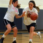 Sophomore Madison Mustoe defends sophomore Jordan Yowell during a drill. Photo by Audrey Kesler