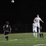 Senior Stanley Morantz returns the goalie's clear with a header down the field. Photo by Haley Bell