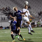 Senior Oliver Bihuniak fights for the header after a throw in. Photo by Haley Bell