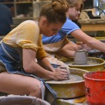 Sophomore Denitza Videnov shapes her tea pot on the pottery wheel. Photo by Morgan Plunkett