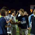 Players from the team cheered on the sidelines after East scored a goal in the second half. Photo by Katherine Odell