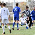 To block senior Stanley Morantz from making a play on goal, the Washburn Rural goalie pushes Morantz to the ground as he cover Morantz's face. There was no foul called on the play. Photo by Haley Bell