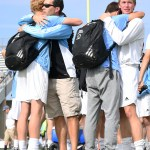 After their final high school soccer game, emotions ran high for senior players. Senior Tommy Kerr hugs Coach Kelly as seniors Oliver Bihuniak and Stanley Morantz hug. Photo by Haley Bell