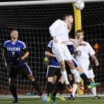 Senior Grayson Rapp heads the ball towards the goal, but the shot was stopped by the goalie. Photo by Haley Bell
