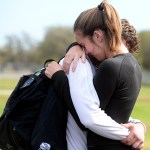 Team manager, senior Porter Caroll, hugs Senior Grayson Rapp before they leave the game. Photo by Kaitlyn Stratman