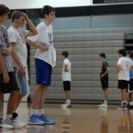 Senior Stanley Morantz, junior Jack Schoemann, and sophomore Noah Kurlbaum watch the other players demonstrate a drill. Photo by Kaitlyn Stratman