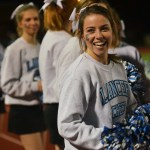 Senior Tyler Lockton smiles back at fellow cheerleaders. Photo by Libby Wilson