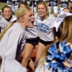 Senior Caroline Keesinger helps the cheer squad get excited for the game. Photo by Izzy Zanone