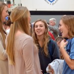 Junior Ally Huffman and senior Gretchen Crum talk with Seniors Ally Offerdahl and Sara Maddox after the signing. Photo by Izzy Zanone