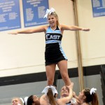 Sophomore Maggie Gray poses while performing a stunt. Photo by Maddie Smiley