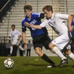 Junior Tommy Nelson tries to get past an ONW defender. Photo by Sophie Storbeck
