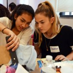 Seniors Mia Rios and Brooklyn Walters staple fabric onto their project. Photo by Sophie Storbeck