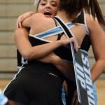 Sophomore Elle Angelo gives Junior Scheele Prust a huge hug before the start of the performance. Photo by Ellie Thoma