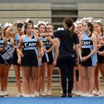 Head Coach Mallory Gaunce gives the cheer squad some last minute pointers before they perform. Photo by Ellie Thoma
