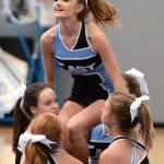 Sophomore Emma Kerwin is hoisted in the air by her bases. Photo by Ellie Thoma
