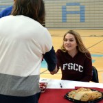 Senior Brooklyn Walters shakes head athletic director Debbie Katzfey's hand. She will be attending Fort Scott Community College to play softball. Photo by Ellie Thoma