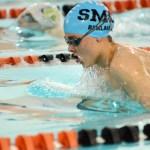 Sophomore Aaron Berlau swims the 100 breastroke. Photo by Luke Hoffman