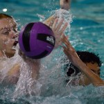 Juniors Patrick Sokoloff and Julian Maran fight for possesion of the ball as they play water polo. Photo by Katherine Odell