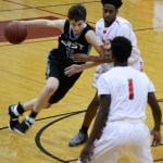 Junior Jack Schoemann dribbles in for a layup. Photo by Carson Holtgraves