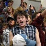 Senior Stephen Shipley cheers on the Lancers with the rest of the student section. Photo by Diana Percy