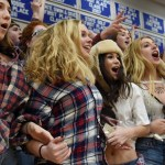 Seniors Kendall Dunbar, Hailey Mohr, Jessica Parker and Sophie Thiede get excited at the tip-off of the Varsity game. Photo by Diana Percy