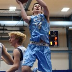 Senior Connor Rieg goes up for a shot, bringing SME's score up to four points. Photo by Diana Percy