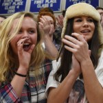 Seniors Hailey Mohr and Jessica Parker cheer on the Lancers. Photo by Diana Percy